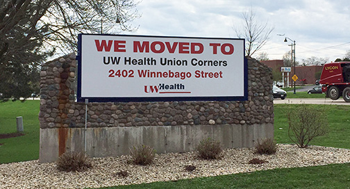 UW We Moved Sign