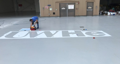Kris Head Installing Vinyl for Helicopter pad